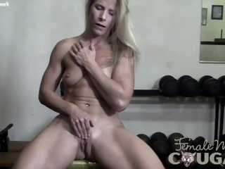 Muscle Cougar Plays With Her..